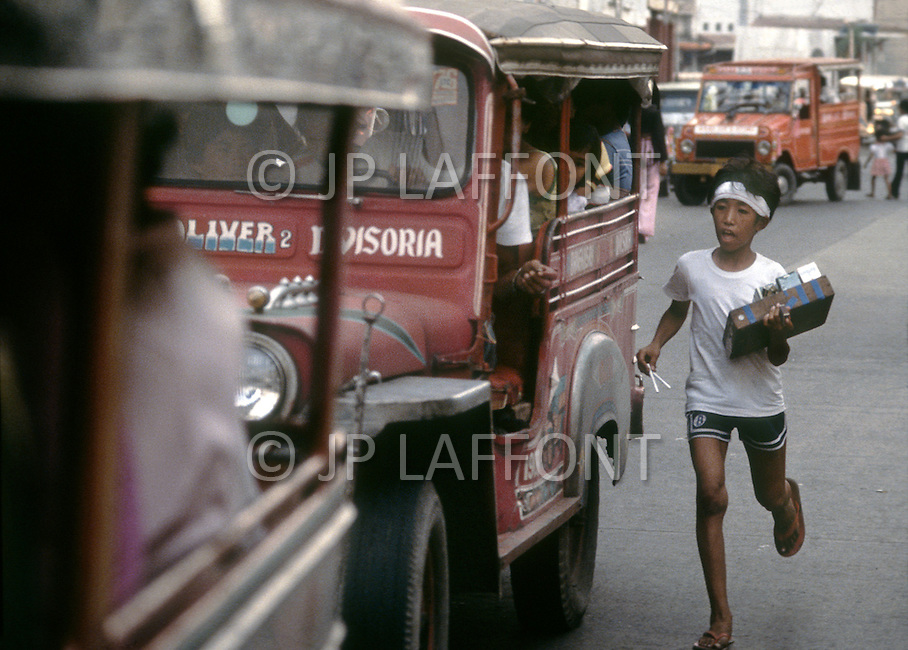 Children selling items on the streets of Manilla, Philippines - Child labor as seen around the world between 1979 and 1980 - Photographer Jean Pierre Laffont, touched by the suffering of child workers, chronicled their plight in 12 countries over the course of one year.  Laffont was awarded The World Press Award and Madeline Ross Award among many others for his work.