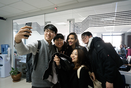 "Palestine, Ramallah, Jan 2017. Students of Handong University of Korea doing a ""selfie"" with Samar Youssef, program coordinator of the Fast-forward accelerator, the first Accelerator in Palestine During the program called ""Global Business Expedition"" they visit world-famous companies– to learn more about achievements of the corporations and latest developments in corporate governance."