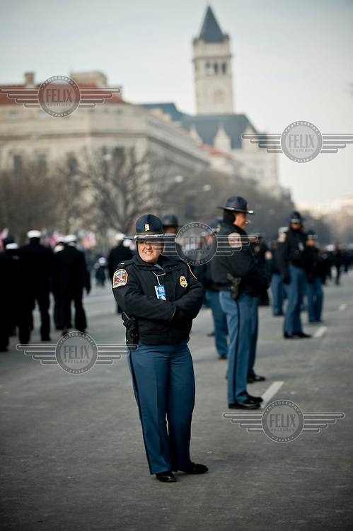 Alabama Police guard the parade route ahead of the inauguration of Barack Obama as the 44th President of the United States. 42,500 police and security personnel watched over the crowd.