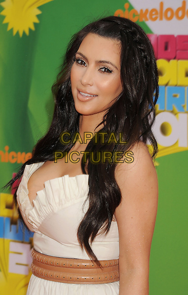 KIM KARDASHIAN.Nickelodeon's 24th Annual Kids' Choice Awards at Galen Center in Los Angeles, California, USA..April 2nd, 2011.half length white cream dress hair beauty cleavage plaits braids strapless ruffle .CAP/ROT/TM.© TM/Roth/Capital Pictures