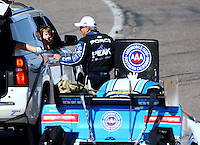 Feb 26, 2016; Chandler, AZ, USA; NHRA funny car driver John Force with grandson Jacob Hood during qualifying for the Carquest Nationals at Wild Horse Pass Motorsports Park. Mandatory Credit: Mark J. Rebilas-