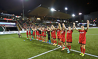 Portland, Oregon - Sunday April 17, 2016: The Portland Thorns FC salute the fans after the match. The Portland Thorns play the Orlando Pride during a regular season NWSL match at Providence Park. The Thorns won 2-1.