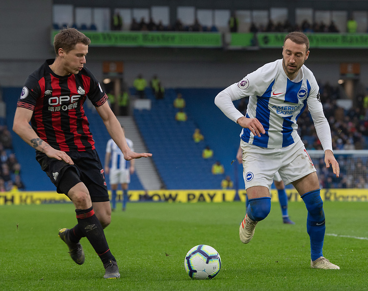 Huddersfield Town's Eric Durm (left)  under pressure from Brighton & Hove Albion's Glenn Murray (right)<br /> <br /> Photographer David Horton/CameraSport<br /> <br /> The Premier League - Brighton and Hove Albion v Huddersfield Town - Saturday 2nd March 2019 - The Amex Stadium - Brighton<br /> <br /> World Copyright © 2019 CameraSport. All rights reserved. 43 Linden Ave. Countesthorpe. Leicester. England. LE8 5PG - Tel: +44 (0) 116 277 4147 - admin@camerasport.com - www.camerasport.com