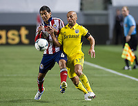 CARSON, CA - March 2, 2013: Chivas defender Walter Vilchez (4) and Columbus forward Federico Higuain (33) during the Chivas USA vs Columbus Crew match at the Home Depot Center in Carson, California. Final score, Chivas USA 0, Columbus Crew 3.
