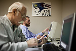 Volunteer Nick Riley, center, calls voters in his precinct in a phone bank at Ron Paul's presidential campaign headquarters in Reno, Nev., January 31, 2012.
