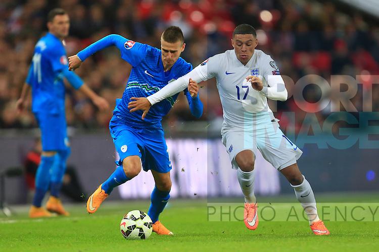 Alex Oxlade-Chamberlain of England skips past a tackle from Andraz Struna of Slovenia - England vs. Slovenia - UEFA Euro 2016 Qualifying - Wembley Stadium - London - 15/11/2014 Pic Philip Oldham/Sportimage