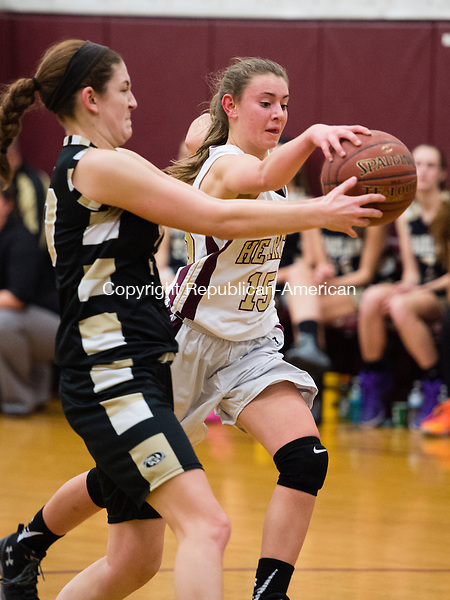 WATERBURY, CT- 11 January 2015-011116EC10-    Sacred Heart's Hayley Tucker drives the ball down the court with pressure from Woodland's Carla Piccolo Monday night. Erin Covey Republican-American