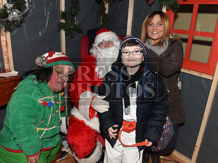 jaden grimes and him mam Charlotte pictured with Santa and Bubbles in Ardee Castle. Photo:Colin Bell/pressphotos.ie