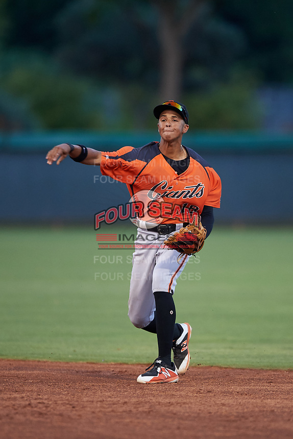 AZL Giants Orange second baseman Edison Mora (18) throws to first base during an Arizona League game against the AZL Dodgers Mota on June 29, 2019 at Camelback Ranch in Glendale, Arizona. The AZL Giants Orange defeated the AZL Dodgers Mota 9-3. (Zachary Lucy/Four Seam Images)