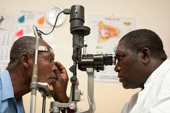 Dr. James Clarke performas a post-operative exame on a patient in his office at the Crystal Eye Clinic in Accra, Ghana. The patient had Retinal Degeneratin.