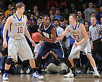 SIOUX FALLS, SD - MARCH 5:  Keaton Moffatt #12 and Reed Tellinghuisen #23 of South Dakota State defend Brandon Conley #5 of Oral Roberts in the 2016 Summit League Tournament. (Photo by Dick Carlson/Inertia)