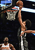Jarrett Allen #31 of the Brooklyn Nets drives to the net for two points and foul during an NBA game against the Phoenix Suns at the Barclays Center in Brooklyn, NY on Sunday, Dec. 23, 2018. The Nets won by score of 111-103.