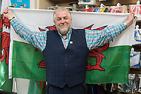 STORY BY STEVEN MORRIS SWANSEA, UK. 5th July 2015. Charles Ashburner from mrflag.com shows off the shop's most popular seller during the Euros.