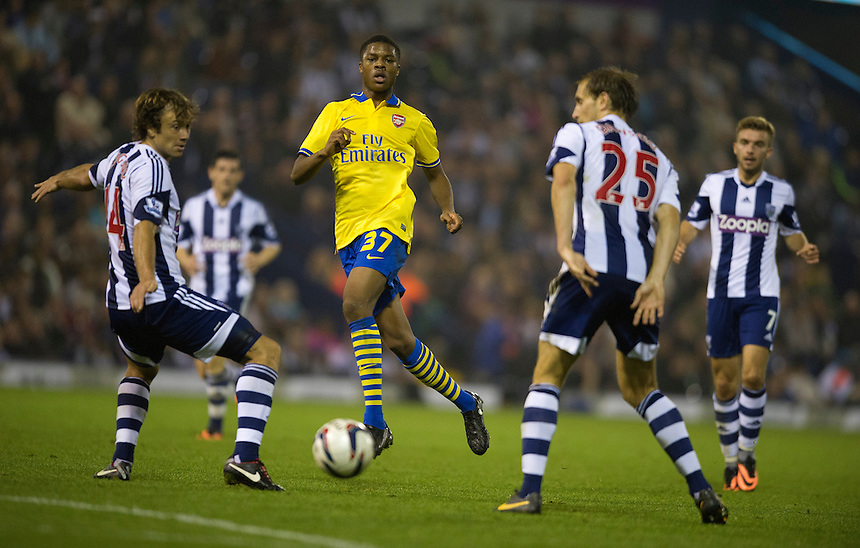 Arsenal's Chuba Akpom passes through the West Bromwich Albion defence<br /> <br /> Photo by Stephen White/CameraSport<br /> <br /> Football - Capital One Cup Third Round - West Bromwich Albion v Arsenal - Wednesday 25th September 2013 - The Hawthorns - West Bromwich<br />  <br /> &copy; CameraSport - 43 Linden Ave. Countesthorpe. Leicester. England. LE8 5PG - Tel: +44 (0) 116 277 4147 - admin@camerasport.com - www.camerasport.com