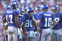 23 September 2007:  Giants QB Eli Manning (10) directs the offensive huddle.  The New York Giants defeated the Washington Redskins 24-17 at FedEx Field in Landover, MD.
