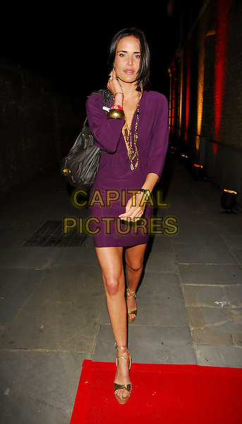 SOPHIE ANDERTON.OK! Magazine - private 10th anniversary party, Old Billingsgate, London, UK..May 10th, 2006.Ref: CAN.full length purple dress necklaces plunging neckline bag purse brown.www.capitalpictures.com.sales@capitalpictures.com.©Capital Pictures