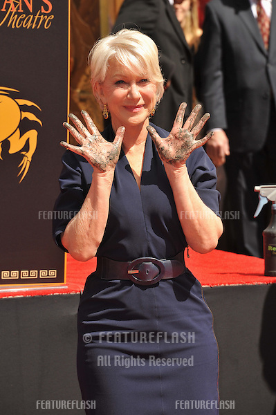 Dame Helen Mirren at Grauman's Chinese Theatre where she was honored by having her hand & footprints set in cement..March 28, 2011  Los Angeles, CA.Picture: Paul Smith / Featureflash