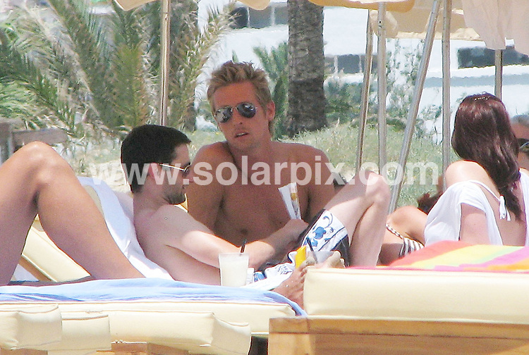 **ALL ROUND EXCLUSIVE PICTURES FROM SOLARPIX.COM**.**NO INTERNET USAGE WITHOUT PRIOR AGREEMENT**.**WORLDWIDE SYNDICATION RIGHTS EXCLUDING SPAIN - NO PUBLICATION IN SPAIN**.Football ace Peter Crouch & model girlfriend Abbey Clancy soak up the sun on a spanish beach. One of Crouchie's lucky mates copped an eyeful when Abbey compared bikini lines with her mate. Her friend then prodded Abbey's right breast as she invited her to guess if they were true or false. Chain smoking Abbey spent the day under a parasol with her pals because of the 100% heat wave that has hit Spain this week. 26th June 2008..JOB REF: 6732 MAD/ROL       DATE: 26_06_2008.**MUST CREDIT SOLARPIX.COM OR DOUBLE FEE WILL BE CHARGED* *UNDER NO CIRCUMSTANCES IS THIS IMAGE TO BE REPRODUCED FOR ANY ONLINE EDITION WITHOUT PRIOR PERMISSION*