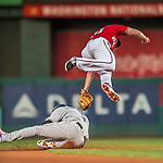29 July 2017: Washington Nationals second baseman Daniel Murphy is unable to tag a sliding Carlos Gonzalez as Gonzalez steals second during a game between the Washington Nationals and the Colorado Rockies at Nationals Park in Washington, DC. The Rockies defeated the Nationals 4-2 in the first game of their 3-game weekend series. Mandatory Credit: Ed Wolfstein Photo *** RAW (NEF) Image File Available ***