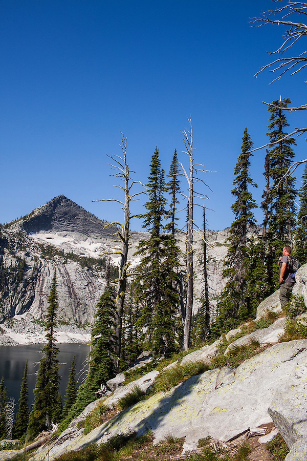 A lone male hikes along the Harrison Lake trail in Northern Idaho in the Selkirk range.