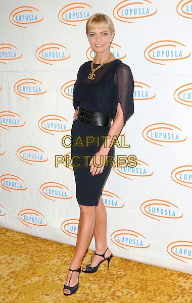 JAIME PRESSLY .arriving at Lupus LA's 7th Annual Bag Ladies Luncheon to raise funds for lupus research at the Beverly Wilshire Four Seasons Hotel in Beverly Hills, California, USA, .November 18th, 2009..full length Jamie Pressley black navy blue sheer dress waist belt t-bar peep toe shoes gold chunky Chanel logo double c's necklace hand on hip see through thru .CAP/ROT.©Lee Roth/Capital Pictures