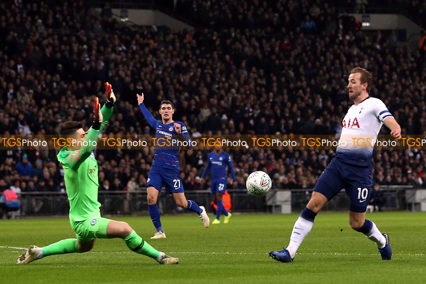 Harry Kane of Tottenham Hotspur races to the ball along with Kepa Arrizabalaga of Chelsea in the incident which led to the penalty being awarded to Tottenham during Tottenham Hotspur vs Chelsea, Caraboa Cup Football at Wembley Stadium on 8th January 2019