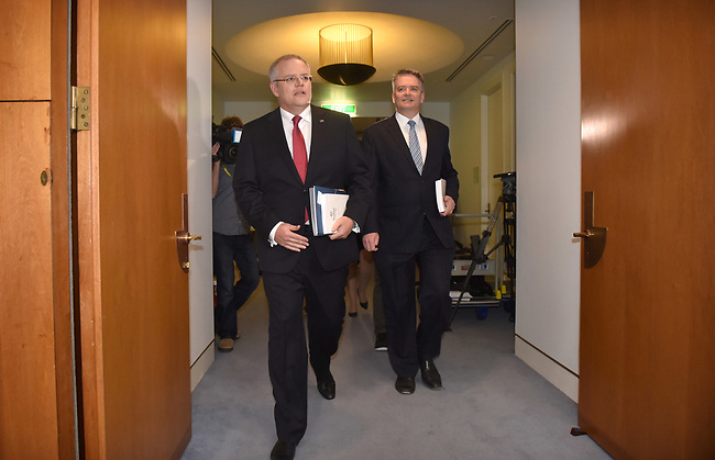 Australian Treasurer Scott Morrison (L) and Finance Minister Mathias Cormann (R) enter the Budget Lockup at Parliament House in Canberra, Australia, on Tuesday, May 9, 2017.  Photographer: Mark Graham/Bloomberg
