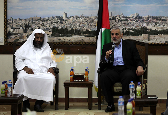 Palestinian Prime Minister in Gaza Ismail Haniyeh meets with members of Saudi Arabia at his office in Gaza City, June 09, 2013. An air bridge between Saudi Arabia and Egypt's El-Arish International Airport started last month carried medicines and medical equipment, which driven from El-Arish to the Rafah border crossing. Photo by Ashraf Amra