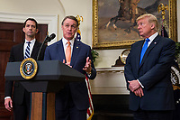 United States Senator David Perdue (Republican of Georgia) makes an announcement on the introduction of the Reforming American Immigration for a Strong Economy (RAISE) Act in the Roosevelt Room at the White House in Washington, D.C., U.S., on Wednesday, August 2, 2017. The act aims to overhaul U.S. immigration by moving towards a &quot;merit-based&quot; system.  Also pictured are US Senator Tom Cotton, a Republican from Arkansas, left, and US President Donald J. Trump, right. <br /> Credit: Zach Gibson / Pool via CNP /MediaPunch