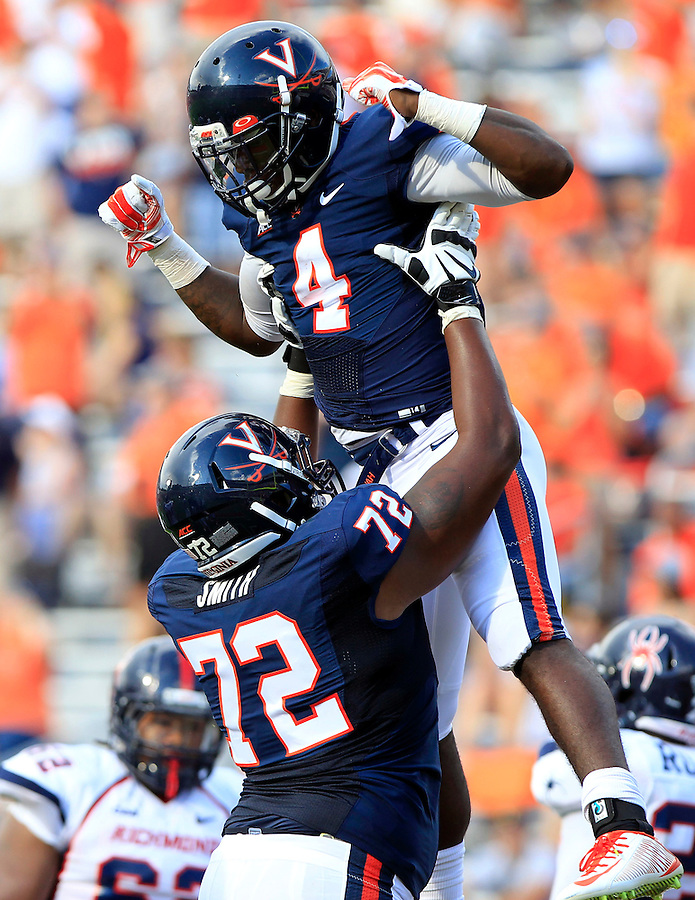 Virginia offensive tackle Eric Smith (72) celebrates the touchdown of teammate running back Taquan Mizzell (4) during the game Saturday Sept. 6, 2014 at Scott Stadium in Charlottesville, VA. Virginia defeated Richmond 45-13. Photo/Andrew Shurtleff