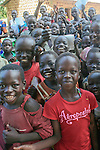 West Mundri County, South Sudan: October 3, 2006.  A group of elementary school students attend a public health session about malaria prevention in W. Mundri County, South Sudan.  The session is conducted by the international public health organization, Population Services International (PSI).