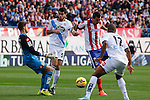 Atletico de Madrid´s Mandzukic (C) and Deportivo de la Coruña´s Insua and goalkeeper Fabricio (L) during 2014-15 La Liga match between Atletico de Madrid and Deportivo de la Coruña at Vicente Calderon stadium in Madrid, Spain. November 30, 2014. (ALTERPHOTOS/Victor Blanco)