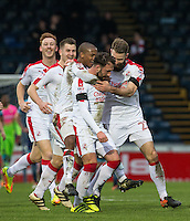 Teammates celebrate with goal scorer Josh Payne of Crawley Town during the Sky Bet League 2 match between Wycombe Wanderers and Crawley Town at Adams Park, High Wycombe, England on 25 February 2017. Photo by Andy Rowland / PRiME Media Images.