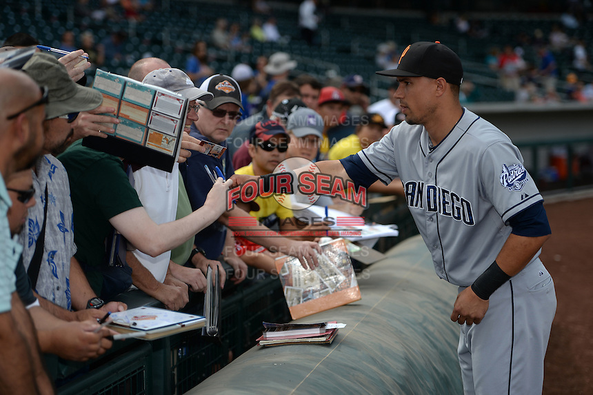 Surprise Saguaros infielder Jace Peterson (33) signs autographs before an Arizona Fall League game against the Mesa Solar Sox on October 17, 2014 at Cubs Park in Mesa, Arizona.  Mesa defeated Mesa 5-3.  (Mike Janes/Four Seam Images)