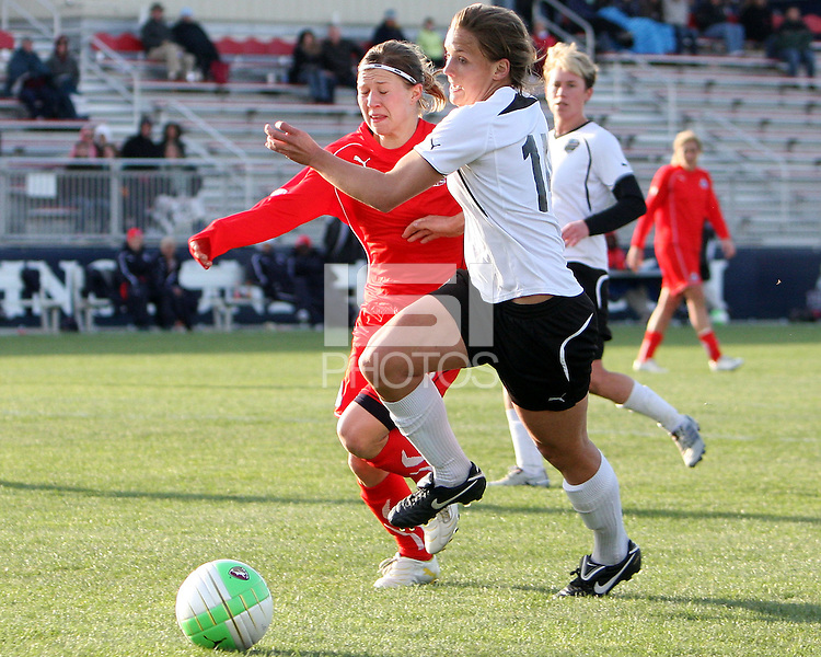 Rebecca Moros #19 of the Washington Freedom races after the ball with Carrie Patterson #14 of the Philadelphia Independence during a WPS pre season match at the Maryland Soccerplex on March 27 2010 in Boyds, Maryland. The game ended in a 0-0 tie.