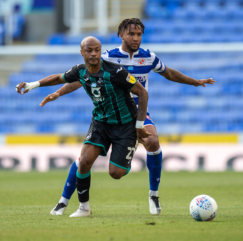 Swansea City's Andre Ayew (left) under pressure from under pressure from Reading's Liam Moore (right) <br /> <br /> Photographer David Horton/CameraSport<br /> <br /> The EFL Sky Bet Championship - Reading v Swansea City - Wednesday July 22nd 2020 - Madejski Stadium - Reading <br /> <br /> World Copyright © 2020 CameraSport. All rights reserved. 43 Linden Ave. Countesthorpe. Leicester. England. LE8 5PG - Tel: +44 (0) 116 277 4147 - admin@camerasport.com - www.camerasport.com