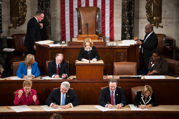 "WASHINGTON, DC- Jan. 05: Rep. Marcy Kaptur, D-Ohio, Rep. Robert A. Brady, D-Pa., Rep. Dan Lungren, R-Calif., and Rep. Ileana Ros-Lehtinen, R-Fla., in front row, and clerks keep a tally as the reading clerk, center, calls each member's name for the roll call vote for the election of Speaker of the U.S. House of Representatives. The final tally was 241 votes for Rep. John A. Boehner, R-Ohio, who becomes the 53rd Speaker; 173 votes for outgoing Speaker Nancy Pelosi, D-Calif., and 19 for other Democrats or voting ""present."" Boehner and Peter A. DeFazio, D-Ore., did not vote. Heath Shuler, D-N.C., a conservative Democrat who opposed Pelosi for Democratic leader to protest what he sees as her failure to chart a centrist course as Speaker, drew 11 of the 19 Democratic protest votes. There were two votes cast for John Lewis, D-Ga., and five for other Democrats, including Minority Whip Steny H. Hoyer, D-Md. One Demcrat voted ""present."" (Photo by Scott J. Ferrell/Congressional Quarterly)"