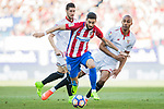 Yannick Ferreira Carrasco (c) of Atletico de Madrid competes for the ball with Steven N'Kemboanza Mike N'Zonzi (r) of Sevilla FC during their La Liga match between Atletico de Madrid and Sevilla FC at the Estadio Vicente Calderon on 19 March 2017 in Madrid, Spain. Photo by Diego Gonzalez Souto / Power Sport Images