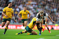Nick Cummins of Barbarians is tackled by Quade Cooper of Australia during the Killik Cup match between Barbarians and Australia at Twickenham Stadium on Saturday 1st November 2014 (Photo by Rob Munro)