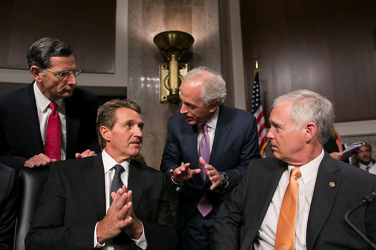 UNITED STATES - JULY 23: From left, Sen. John Barrasso, R-Wyo., Sen. Jeff Flake, R-Ariz., Committee chairman Sen. Bob Corker, R-Tenn., and Sen. Ron Johnson, R-Wis., speak before the Senate Foreign Relations Committee hearing on the Iran Nuclear Agreement on Thursday, July 23, 2015. Secretary of State John Kerry, Energy Secretary Ernest Moniz, and Treasury Secretary Jack Lew testified. (Photo By Al Drago/CQ Roll Call)