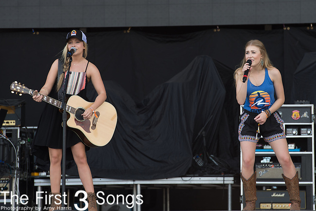 Madison Marlow and Taylor Dye of Maddie & Tae perform onstage during The Tortuga Music Festival in Fort Lauderdale, Florida.