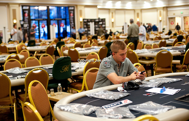 Pokerstars qualifier Corey Thompson sits at his table before the start o play on Day 1A.