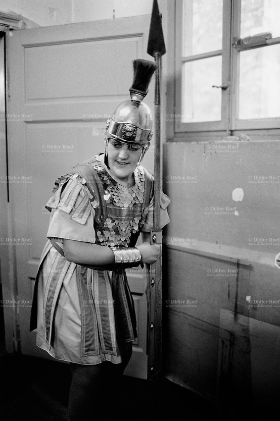 Switzerland. Canton Ticino. Mendrisio. A young boy, dressed up as a roman legionary soldier, holds a spear in his hand. The teenager is getting ready for the historical and religious Good Friday processions. Good Friday is a Christian holiday commemorating the crucifixion of Jesus and his death at Calvary. It is observed during Holy Week on the Friday preceding Easter Sunday, It is also known as Holy Friday, Great Friday and Black Friday. © 2001 Didier Ruef