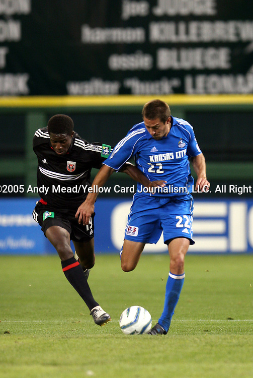 21 May 2005: Clyde Simms (19) and Davy Arnaud (22) battle for the ball. DC United defeated the Kansas City Wizards 3-2 at RFK Stadium in Washington, DC in a regular season Major League Soccer game. . .