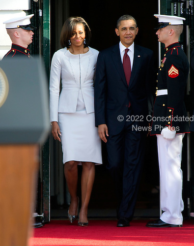 United States President Barack Obama and first lady Michelle Obama walk out of the Diplomatic Entrance as they prepare to welcome Prime Minister David Cameron and his wife, Samantha, to the White House in Washington, D.C. on Wednesday, March 14, 2012..Credit: Ron Sachs / CNP
