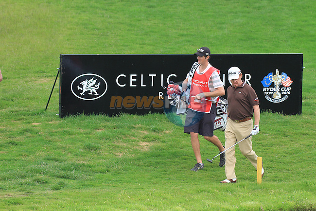 Miguel Angel Jimenez anoyed after playing his drop shot on the 18th on day three of the Celtic Manor wales Open 2010.Picture Fran Caffrey/Newsfile.ie