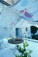 Hand-painted antique linen is draped over the roof terrace