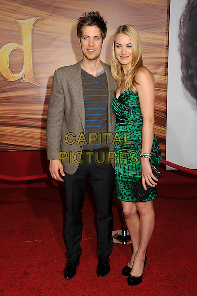 "GUEST & YVONNE STRAHOVSKI.""Tangled"" Los Angeles Premiere held at the El Capitan Theatre, Hollywood, California, USA..November 14th, 2010.full length leopard print dress black green strapless shoes clutch bag beige jacket grey gray trousers .CAP/ADM/BP.©Byron Purvis/AdMedia/Capital Pictures."