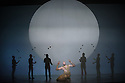 """EMBARGOED UNTIL FRIDAY 4th MARCH 2016, 7:30pm: London, UK. 02.03.2016. English National Opera presents """"Akhnaten"""", composed by Philip Glass, and directed by Phelim McDermott. Picture shows: Zachary James (Scribe), skills ensemble, Gandini Juggling.Photograph © Jane Hobson."""