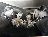 BNPS.co.uk (01202 558833)<br /> Pic: Marlows/BNPS<br /> <br /> Gretl Braun receiving wedding gifts.<br /> <br /> Taken just three days before D-Day this remarkable photo shows Adolf Hitler celebrating the wedding of his brother-in-law - who he had executed a year later.<br /> <br /> The previously unseen image shows the Nazi dictator congratulating Hermann Fegelein and bride Gretl Braun, little realising that the course of the Second World War was about to turn against him.<br /> <br /> It was found in a gallery of 12 snaps of the wedding reception that lasted for thee days and was organised by Eva Braun, the elder sister of Gretl and Hitler's mistress.<br /> <br /> The fuhrer was one of the witnesses to the marriage along with SS chief Heinrich Himmler and Martin Bormann, Hitler's private secretary.<br /> <br /> The 12 black and white photos taken at her first wedding have sold at Marlows auctioneers of Stafford for &pound;400.